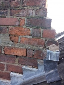 Photo of poorly maintained chimney stack