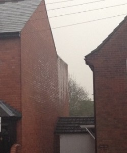Photo showing rain wetting of masonry walls is made worse by lack of coping