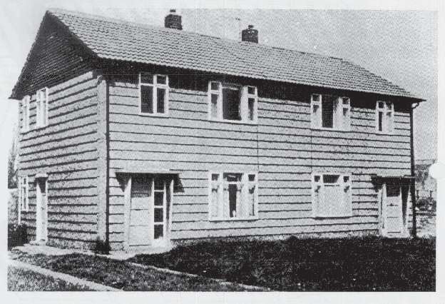 Photo of an Airey house with typical shiplapped appearance